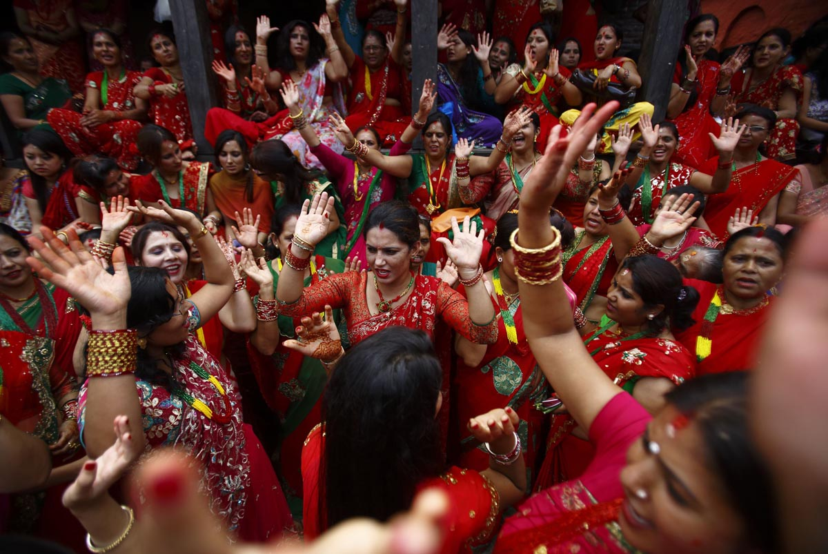 Women sing and dance at Pashupatinath Temple during the Teej festival in Kathmandu